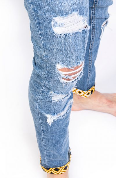 Light blue ripped jeans side