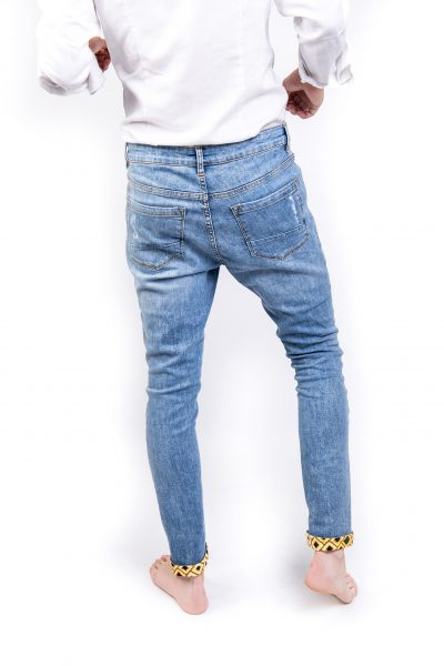 Light blue ripped jeans back